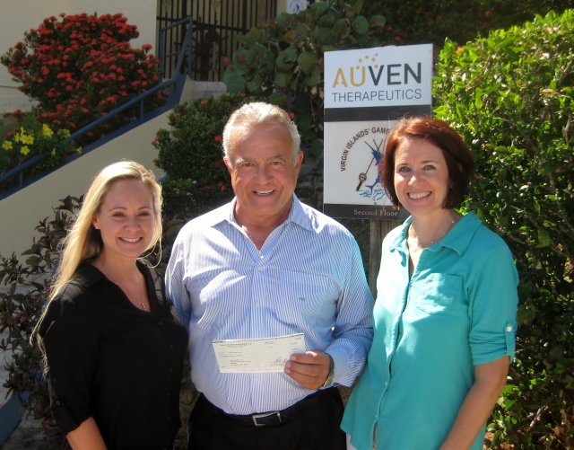 Kristy Solt (l) and Leah Casteel (r) accept donation from Dr. Peter B. Corr of Auven Therapeutics.